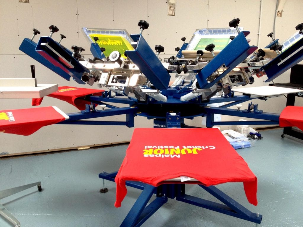 Printing multiple colors on the clothing item can be done with screen printing